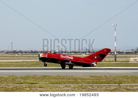 """GLENDALE, AZ - MARCH 21: Bill Reesman lands a Russian MiG-17 at the biennial air show (""""Thunder in the Desert"""") at Luke Air Force Base on March 21, 2009 in Glendale, AZ."""