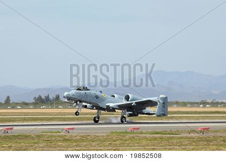"GLENDALE, AZ - MARCH 21: A U.S. Air Force A-10 Thunderbolt lands on the runway at the biennial air show (""Thunder in the Desert"") at Luke Air Force Base on March 21, 2009 in Glendale, AZ."