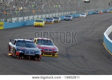 AVONDALE, AZ - APRIL 18: David Stremme #12 leads a group of cars in the NASCAR Sprint Cup race at the Phoenix International Raceway on April 18, 2009 in Avondale, AZ.