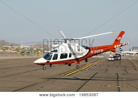 PHOENIX, AZ - MAY 13: A Phoenix police helicopter lifts off as President Barack Obama's motorcade arrives at Phoenix Sky Harbor Airport on May 13, 2009 in Phoenix, AZ.