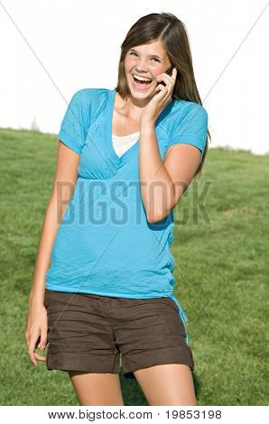 Pretty teenage girl talking on cell phone