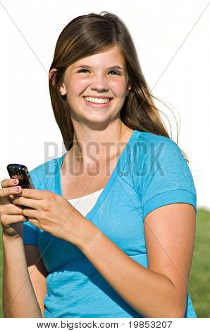 Pretty teenage girl sending text message