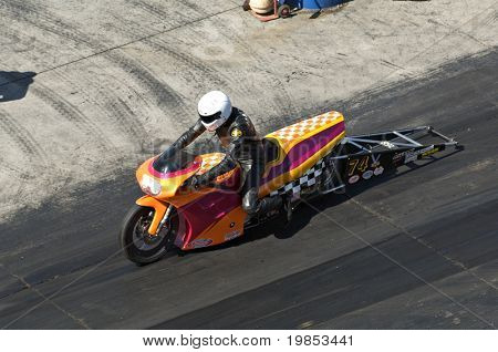 CHANDLER, AZ - OCTOBER 2: A motorcycle competes in the NHRA Pacific Division drag racing championship on October 2, 2009 in Chandler, Arizona.