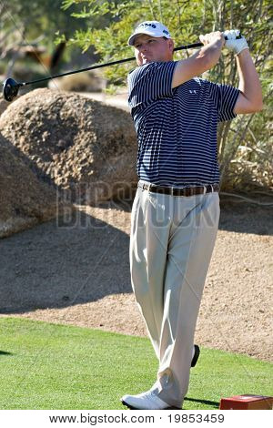 SCOTTSDALE, AZ - OCTOBER 21: Chad Campbell hits a drive in the Frys.com Open PGA golf tournament on October 21, 2009 in Scottsdale, Arizona.
