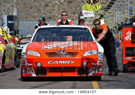 AVONDALE, AZ - APRIL 10: The pit crew pushes the #20 Home Depot Toyota car, driven by Joey Logano, onto the track before the start of the Subway Fresh Fit 600 on April 10, 2010 in Avondale, AZ.