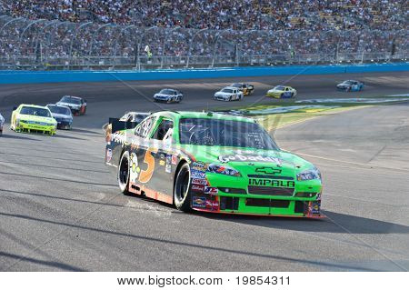 AVONDALE, AZ - APRIL 10: Mark Martin (#5) leads a group of cars out of turn one at the Subway Fresh Fit 600 NASCAR Sprint Cup race on April 10, 2010 in Avondale, AZ.