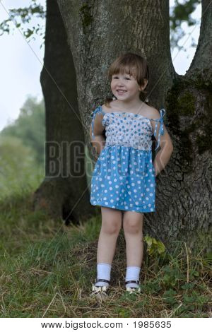 Cheerful Little Girl In The Woods