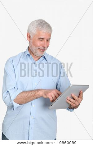 Senior man using electronic tablet