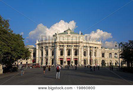 "View of the ""Burgtheater""  in Vienna, Austria against a blue sky."