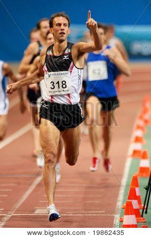 VIENNA, AUSTRIA - FEBRUARY 3, 2009: International indoor track and field meeting in Vienna: Ate van der Burgt, Netherlands, wins the mens 1500m running competition.