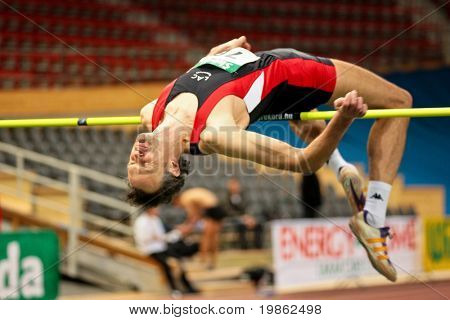 VIENNA, AUSTRIA - FEBRUARY 21: Indoor track and field championship: Guenther Gasper places third in the men's high jump event February 21, 2009 in Vienna, Austria.