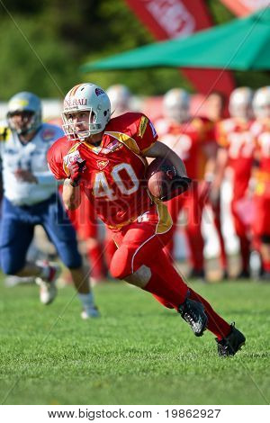 ST POELTEN,  AUSTRIA - APR 25: Austrian Football League - Division I: SS Hannes Baumgartner (#40, Invaders) and his team win against the Traun Steelsharks  on April 25, 2009 in St Poelten, Austria.