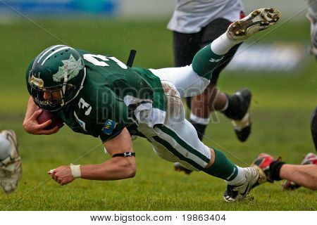 KORNEUBURG,  AUSTRIA - JUNE 20: Austrian Football League: RB Andrej Kliman (#3, Dragons) and his team win 41:35 against the Carinthian Black Lions on June 20, 2009 in Korneuburg, Austria.
