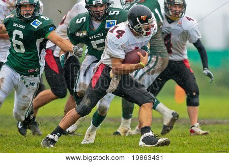 KORNEUBURG,  AUSTRIA - JUNE 20 Austrian Football League: QB DJ Hernandez (#14, Lions) and his team lose 41:35 to the Danube Dragons on June 20, 2009 in Korneuburg, Austria.