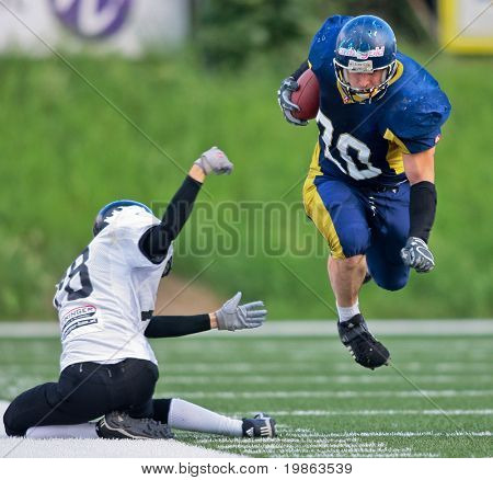 VIENNA,  AUSTRIA - JULY 4: Austrian Football League - Iron Bowl II: RB Lars Gabler (#20, Titans) and his team win 26:20 against the Vienna Knights on July 4, 2009 in Vienna, Austria.