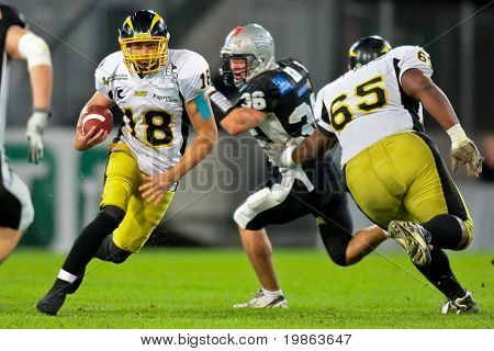 INNSBRUCK,  AUSTRIA - JULY 11 European Football League - Euro Bowl XXIII:  Yohann Rouat (#18, Flash) and his team lose 30:19 to the Tirol Raiders on July 11, 2009 in Innsbruck, Austria.