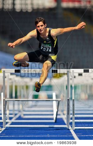 LINZ, AUSTRIA - AUGUST 2 : Philipp Huber (No. 237) finishes fifth in the men's 110m hurdles event at Austrian track and field championship August 2, 2009 in Linz, Austria.