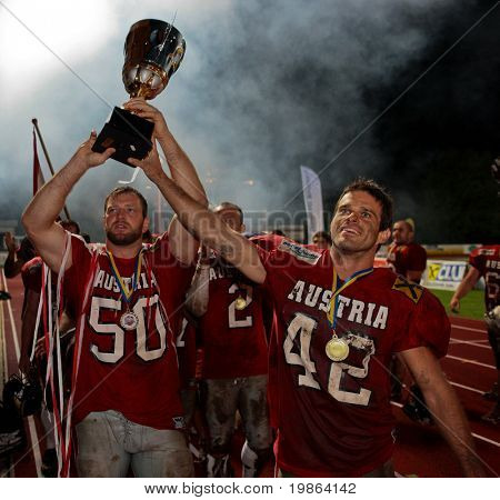 WOLFSBERG, AUSTRIA - AUGUST 22 American Football B-EC: DB Christoph Schreiner (#42, Austria) and DL Mario Rinnner (#50, Austria) celebrate the championship on August 22, 2009 in Wolfsberg, Austria.