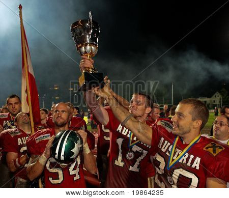WOLFSBERG, AUSTRIA - AUGUST 22 American Football B-EC: WR Florian Starzengruber (#17, Austria) and his team celebrate the championship on August 22, 2009 in Wolfsberg, Austria.