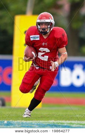 WOLFSBERG, AUSTRIA - AUGUST 18 American Football B-EC: RB Dan Klatoft B?hm (#2, Denmark) and his team lose 15:30 against Czech Republic on August 18, 2009 in Wolfsberg, Austria.
