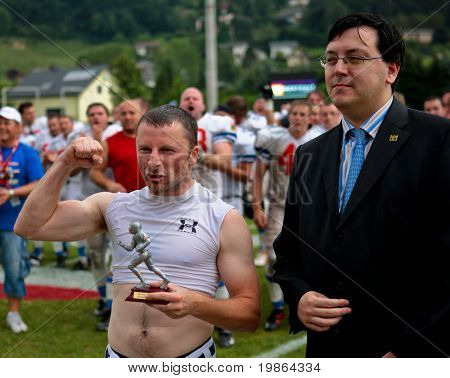 WOLFSBERG, AUSTRIA - AUGUST 22: American Football B-EC: RB Stanislay (#9 , Czech) gets the MVP-trophy from EFAF presdient Robert Huber  August 22, 2009 in Wolfsberg, Austria.