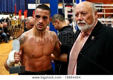 VIENNA, AUSTRIA - OCTOBER 3 Charity Boxing: Marcos Nader (left, Austria) and FVA president Willibald Palatin after Nader's middle weight fight on October 3, 2009 in Vienna,  Austria.