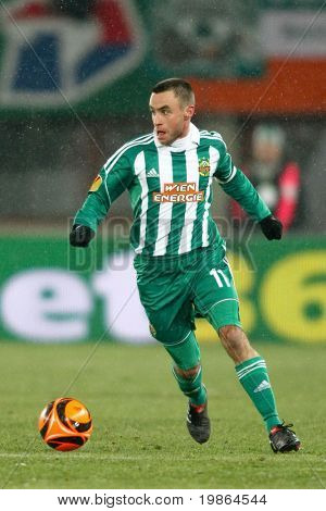 VIENNA,  AUSTRIA - DECEMBER 17: SK Rapid plays 3:3 to Celtic Glasgow on December 17, 2009 in Vienna, Austria. Shown is midfielder Steffen Hofmann (#11, Rapid).