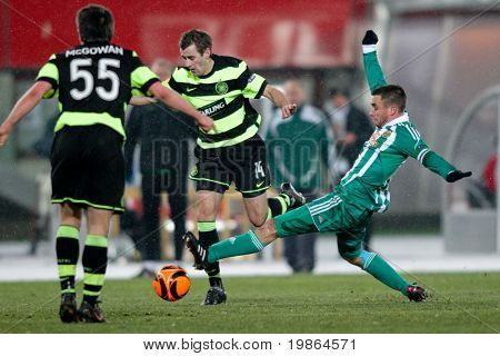 VIENNA,  AUSTRIA - DECEMBER 17: SK Rapid plays 3:3 to Celtic Glasgow on December 17, 2009 in Vienna, Austria. Shown are midfielders Niall McGinn (#14, Celtic) and Steffen Hofmann (#11, Rapid).