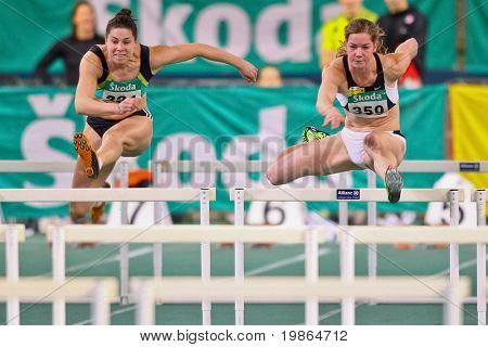 VIENNA, AUSTRIA - FEBRUARY 19: Indoor track and field championship. Beate Schrott (#359, Austria) wins the women's 60m hurdles event on February 19, 2011 in Vienna, Austria.