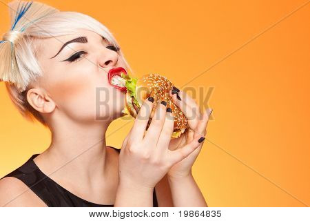 closeup portrait of glamorous girl eating burger