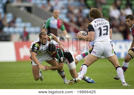 TWICKENHAM UK AUGUST 03, Gavin Platt throws the ball to Jamie langley as he is tackled while Playing in the Engage Super League Rugby league match Between Harlequins RL and Bradford Bulls