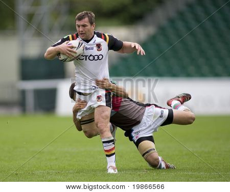TWICKENHAM UK AUGUST 03, Lestyn Harris is tackled as he runs with the ball  Playing in the Engage Super League Rugby Leage match Between Harlequins RL and Bradford Bulls at The Stoop, Twickenham