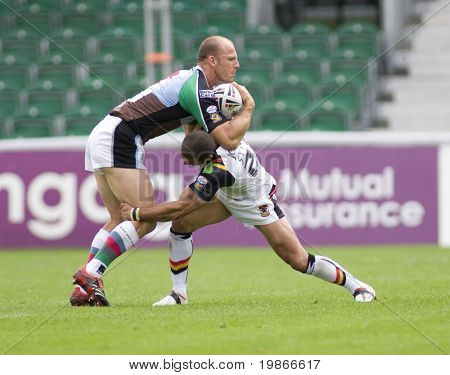 TWICKENHAM UK AUGUST 03, Paul Sykes attempts to tackle Scott Hill Playing in the Engage Super League Rugby league match Between Harlequins RL and Bradford Bulls at The Stoop, Twickenham London