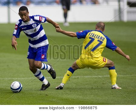 LONDON, UK AUGUST 2,Vincenzo Italiano attempts to foul Mikele Leighterwood at the pre-season friendly football match between QPR and Chievo,