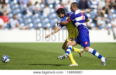 LONDON, UK AUGUST 2, Marco Malago holds off a defender at the pre-season friendly football match between QPR and Chievo,