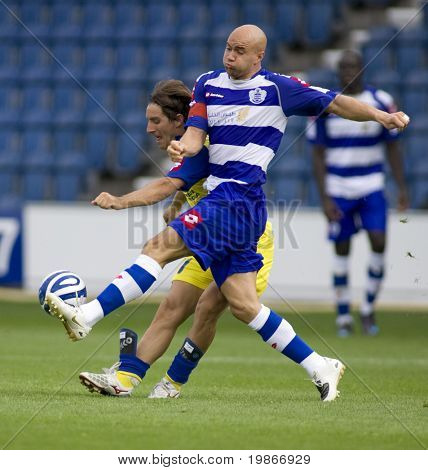 LONDON, UK AUGUST 2,Gavin Mahon muscles Vincenzo Italiano off the ball at the pre-season friendly football match between QPR and Chievo,