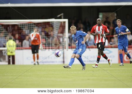 LONDON, UK AUGUST 16, Martin Butler side foots a ball while playing in the Coca-Cola football league two match between Brentford and Grimsby town at Griffin Park London August 16, 2008