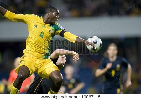 LONDON, UK AUGUST 19, Aaron Mokoena leaps for a ball playing in the international football friendly match between Australia and South Africa held at Loftus Road London 19/08/2008