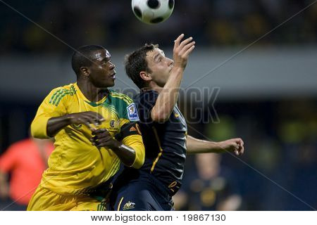 LONDON, UK AUGUST 19 Aaron Mokoena and Luke Wilkshire compete for the ball playing in the international football friendly match between Australia and South Africa held at Loftus Road London 19/08/2008