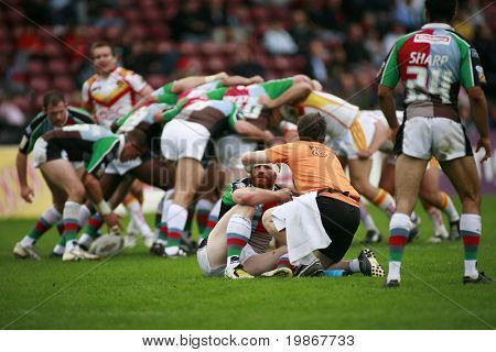 TWICKENHAM London UK September 07, Jon Wells gets a head wound seen to whilst the scrum carries on behind him during the Engage Super League, Rugby  match Between Harlequins RL and Catalan Dragons