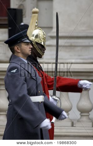 WHITEHALL, LONDON - NOV 8: The Royal Air Force and the Life Guards march together at the Royal British Legion Remembrance Parade at the Cenotaph November 8, 2009 in Whitehall, London.