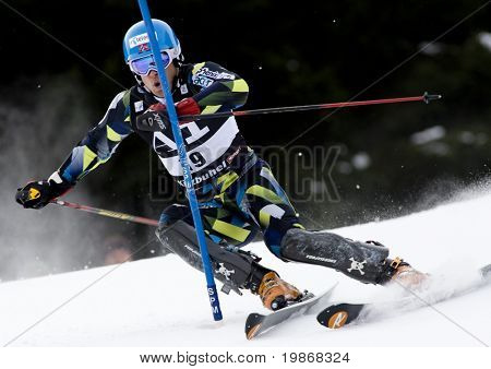 KITZBUEHEL - JANUARY 24: Lars Elton Myhre (NOR) attacks a control gate while competing in the men's Hahnenkamm slalom race part of the 70th Hahnenkamm Rennen on January 24, 2010 in Kitzbuehel, Austria