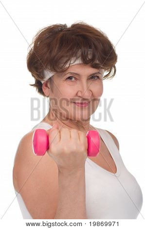 Portrait of senior woman with dumbells