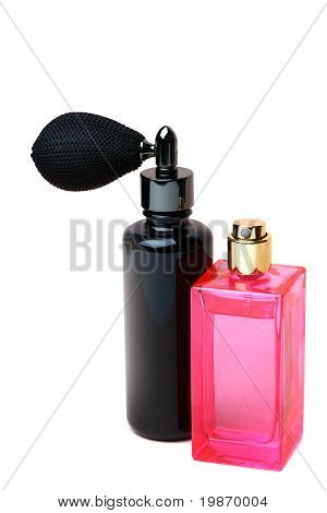 Black And Pink Perfume Bottles On White Background.