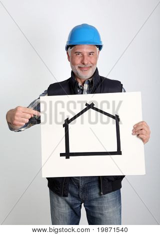 Property developer showing house for sale sign