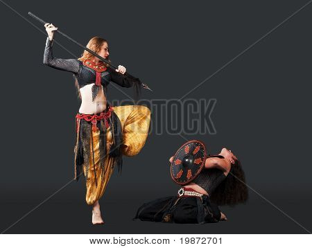 Man and woman fight with spear and shield - arabia
