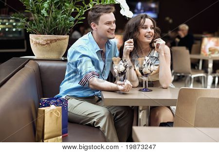 Smiling couple eating ice cream