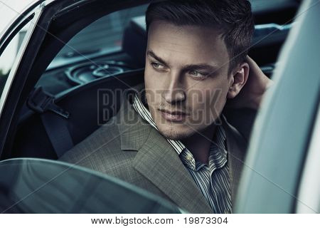 Handsome man in car
