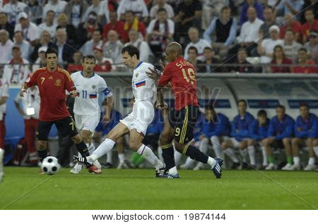INNSBRUCK - JUNE 10: Marcos Senna of Spain (in red) & Konstantin Zyryanov of Russia (in white) during the match Spain-Russia 4:1 Euro2008 Group D. June 10, 2008, in Innsbruck, Austria
