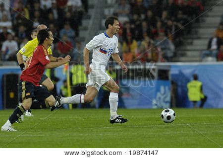 INNSBRUCK - JUNE 10: Konstantin Zyryanov of Russia (in white) & David Silva of Spain (in red)  during the match Spain-Russia 4:1 Euro2008 Group D. June 10, 2008, in Innsbruck, Austria